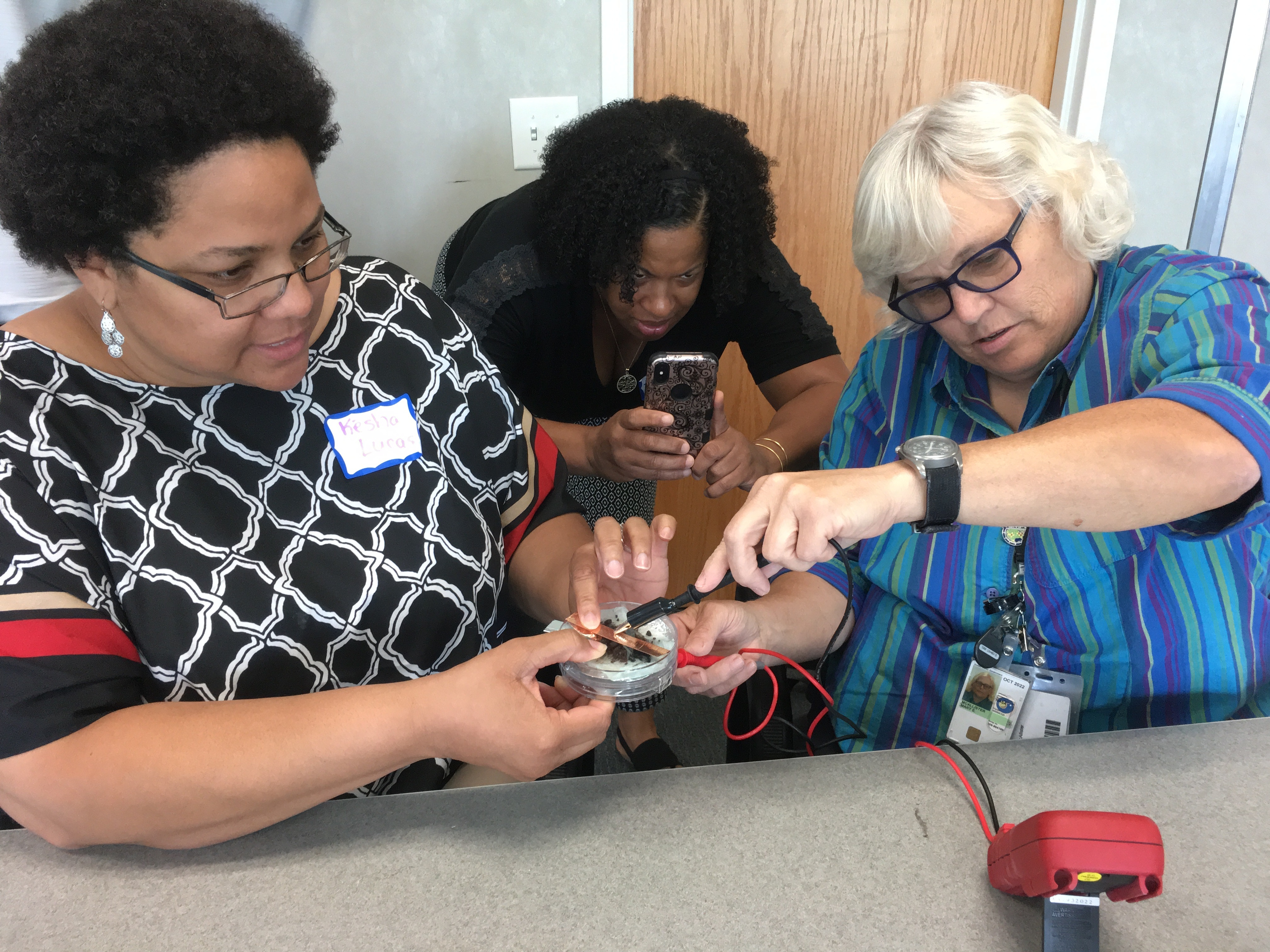 teachers testing their DIY aluminum air battery